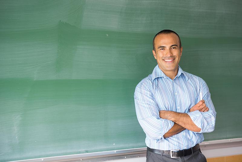 Teacher-in-front-of-Chalkboard